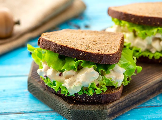The best chicken salad recipe on sliced bread with lettuce